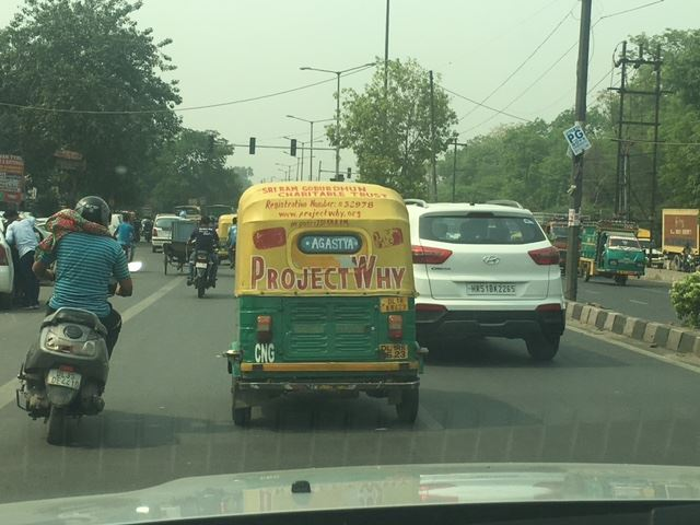 The auto rickshaw and the BMW #Giving Tuesday#India